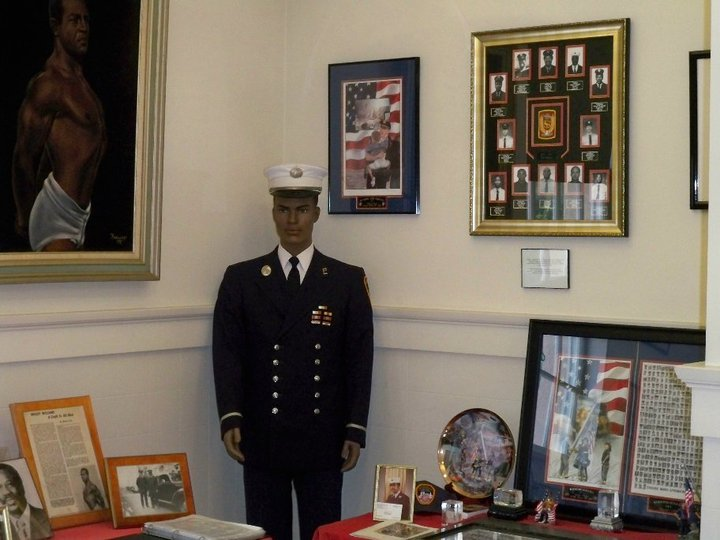 Another View of the International Room. Here is a display of an FDNY uniform that was worn by retired Lieutenant Bill High. There is also a tribute to Retired Battalion Chief Wesley Williams, a founding member of the Vulcan Society of the FDNY and a tribute to the 343 FDNY Firefighters that perished during the 9-11 attack on the world trade center.